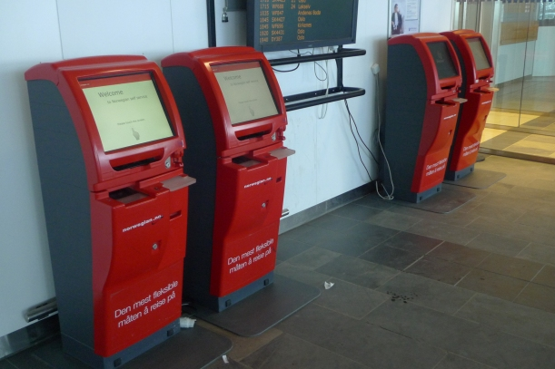 The robot-like check-in assistants at Tromsø airport in Norway